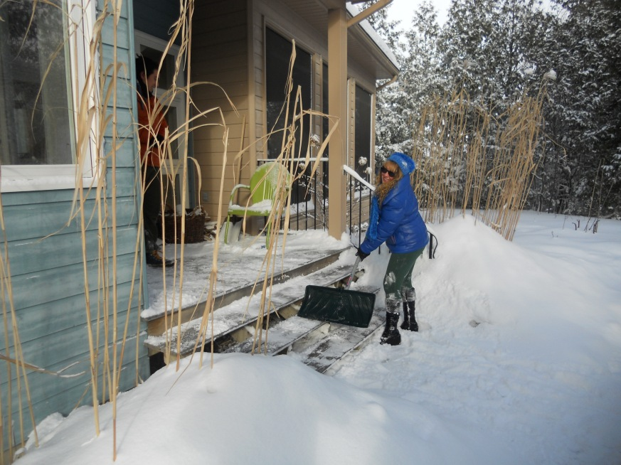 shoveling snow in winter houses