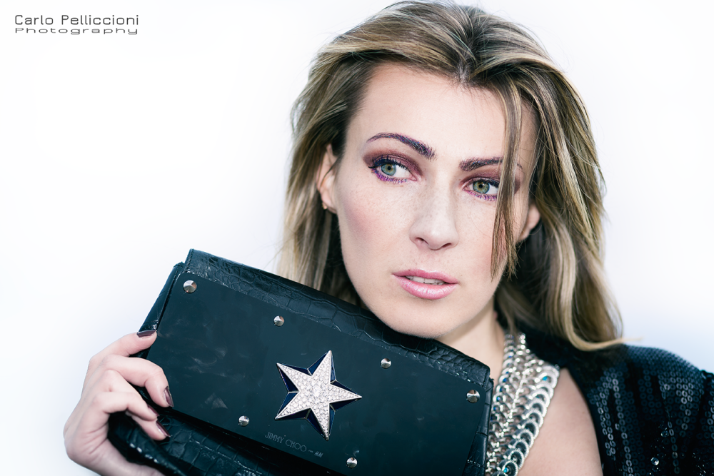 inessa fashion blogger model black star purse