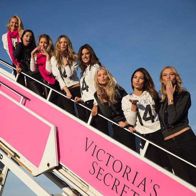 victoria secret models boarding plane flight NY London