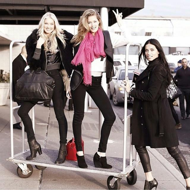 vs models doutzen adriana and behati fooling around at the airport luggage rail